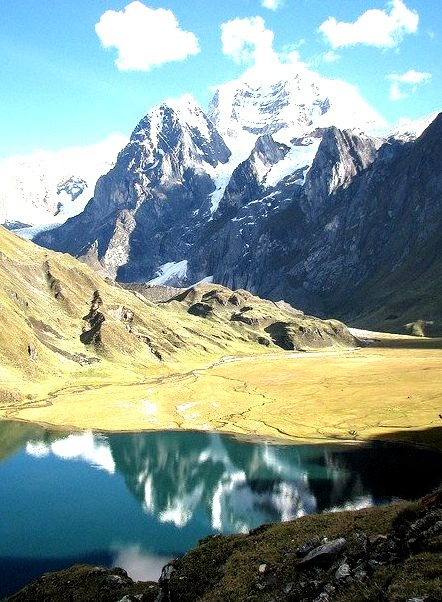 Reflections on a glacier lake in Huayhuash Range, Peru
