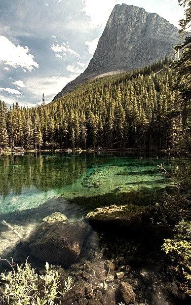 Ha-Ling peak rising over Lower Grassi Lake, Alberta / Canada